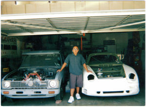 My Toyota Pickup with a Ford 32 sitting inside my garage next to my 76 930 Porsche Turbo 911.